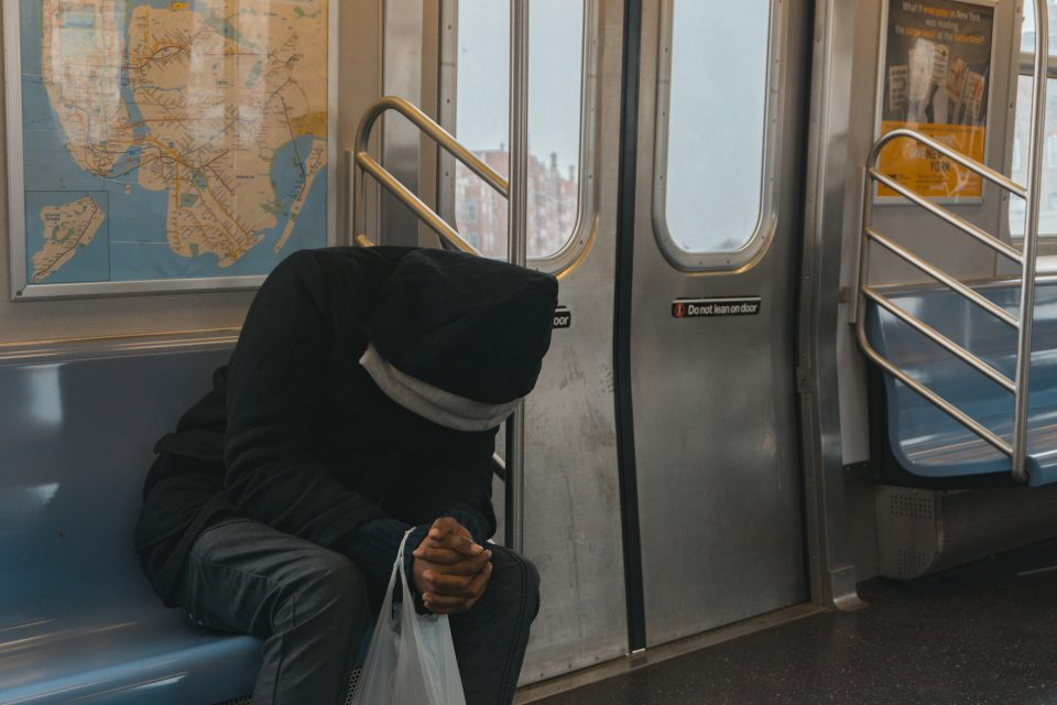 person-in-black-hoodie-sitting-on-train-bench-362948-960x640.jpg