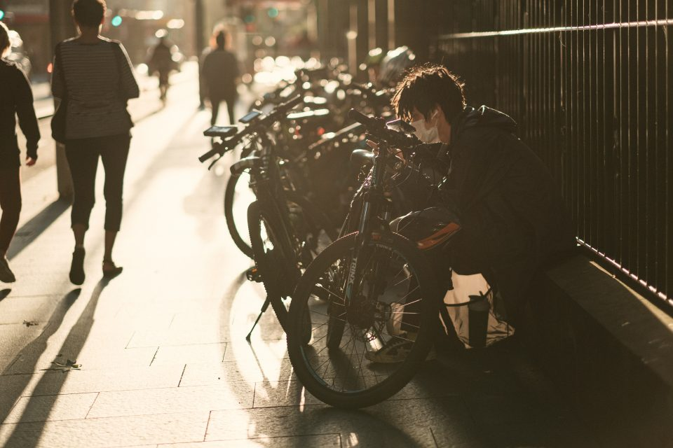 man-in-black-jacket-in-front-of-bicycle-4008393-960x640.jpg