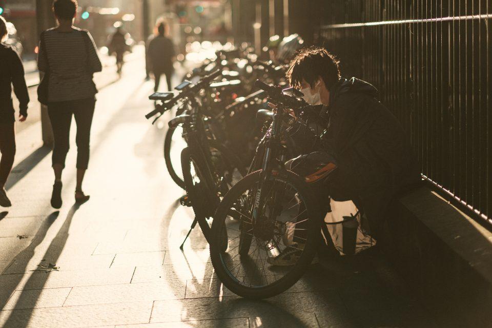 man-in-black-jacket-in-front-of-bicycle-4008393-960x640.jpg